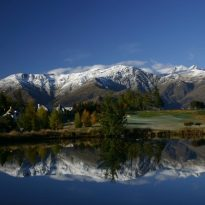 The Remarkables (Queenstown, South Island, New Zealand) are reflected in one of the ponds at Millbrook Golf Resort.